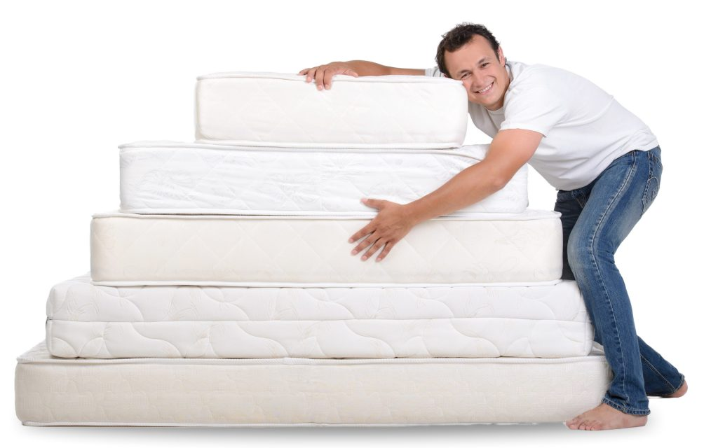 funny-man-pajamas-sitting-lots-mattresses-scaled